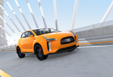 Yellow electric SUV driving on arc bridge Royalty Free Stock Photos