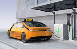 Yellow electric taxi charging in charging station Stock Image