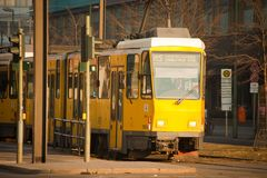 Yellow electric tram in Berlin Stock Images
