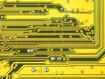Yellow electronic microcircuit.Background. Royalty Free Stock Images