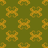 Yellow elements on a green background. Seamless pattern. Stock Photo