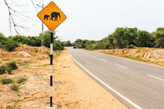 Yellow elephant wanring sign on the road Stock Image