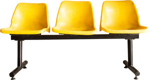 Yellow empty chairs under the white background Stock Image