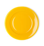 Yellow empty plate. On white background royalty free stock photos