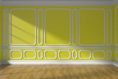 Yellow empty room wall with molding and parquet floor. Yellow empty room wall interior with sunlight from window, decorative classic style molding on walls Royalty Free Stock Image
