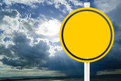 Yellow empty sign. On background the time in the evening when the sun disappears or daylight fades Stock Image