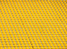 Yellow empty stadium seats. In a row Royalty Free Stock Photography