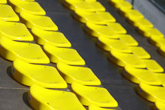 Yellow empty stadium seats Stock Photo