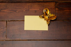Yellow envelope with butterfly. Yellow envelope and crystal butterfly on the wooden table stock photo