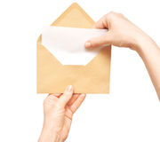Yellow envelope in the hand Royalty Free Stock Photography