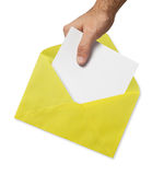 Yellow envelope and hand Royalty Free Stock Photos