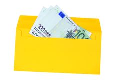 Yellow envelope with money Stock Images