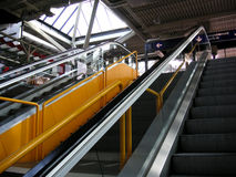 Yellow escelator. With stairs in the middle royalty free stock images