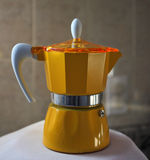 Yellow  espresso maker Royalty Free Stock Photography