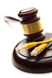Yellow ethernet cable and gavel Royalty Free Stock Images