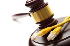 Yellow ethernet cable and gavel. Yellow ethernet cable and wooden gavel Royalty Free Stock Photos