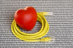 Yellow Ethernet cable and red heart on white background with numbers. Studio shot royalty free stock images