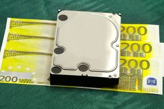 Yellow 200 Euro and hard drive data disc royalty free stock images