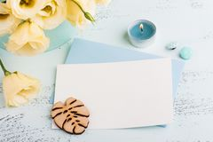 Yellow eustoma flowers and envelope. On blue table. Greeting card for Birthday, Womens or Mothers Day Stock Photography