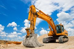 Yellow Excavator. On a construction site against blue sky Stock Images