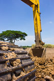 Yellow Excavator. At Land For cultivation Stock Image