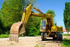 Yellow excavator stock photos