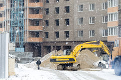 Yellow excavator with a big bucket Stock Photography