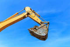 Excavator bucket againest the blue Sky Royalty Free Stock Images