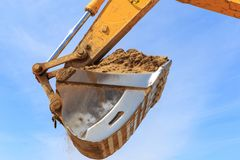 Excavator bucket againest the blue Sky Royalty Free Stock Photography