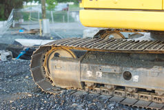 Yellow excavator closeup construction site heavy tools bulldozer machine Stock Photos