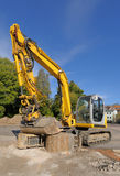 Yellow excavator on a construction site Royalty Free Stock Image
