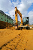 Yellow excavator on the construction site Stock Photography