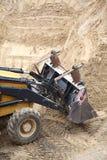 Yellow excavator construction site Stock Image