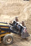 Yellow excavator construction site Royalty Free Stock Photography