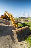 Yellow excavator at construction site Royalty Free Stock Photo