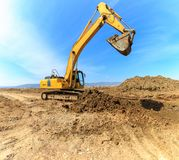 Yellow excavator on a construction Stock Photography