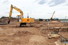 Yellow excavator on a construction site Royalty Free Stock Photo
