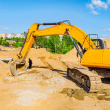 Yellow excavator on a construction site. Stock Photos
