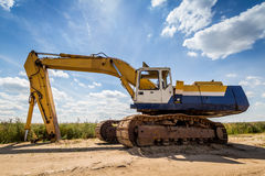Yellow Excavator. At Construction Site. Wide angle view Royalty Free Stock Images