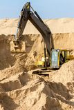 Yellow Excavator at Construction Site Royalty Free Stock Images