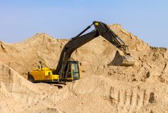 Yellow Excavator at Construction Site Stock Photography
