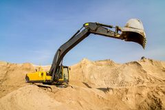 Yellow Excavator at Construction Site Stock Images