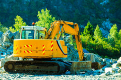 Yellow excavator, digger on construction site Stock Photos