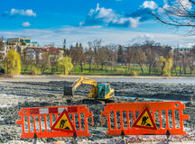 Yellow excavator doing lake cleaning and maintenance services Royalty Free Stock Photos