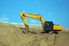 Yellow excavator, excavation work at a Royalty Free Stock Photo