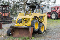 Yellow excavator in a grader parked Royalty Free Stock Images