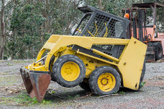 Yellow excavator in a grader parked Royalty Free Stock Photos