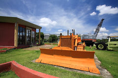 Yellow excavator on the grass Royalty Free Stock Photos
