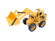 Yellow excavator in half a turn. Toy yellow excavator with a raised bucket Royalty Free Stock Photo