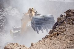 Yellow Excavator Is Filling A Dump Truck With Rocks At Coal Mines Royalty Free Stock Photo
